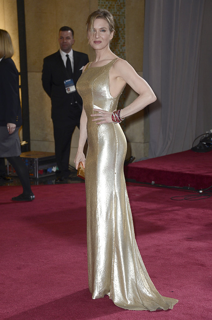 Renée Zellweger looked statuesque in a formfitting liquid gold Carolina Herrera gown.