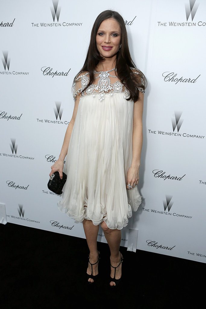 Marchesa's designer Georgina Chapman, who's married to Harvey Weinstein, looked elegant in one of her ethereal creations.