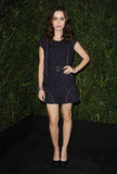 Lily Collins wore a Chanel navy-and-pink tweed shorts jumpsuit and vest, which offered a modern take on the label's signature tweedy looks, at the Chanel dinner.