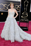 Amy Adams stepped out on the Oscars red carpet wearing a dove-gray ball gown from Oscar de la Renta showcasing delicate beading and copious amounts of ruffled tiers.