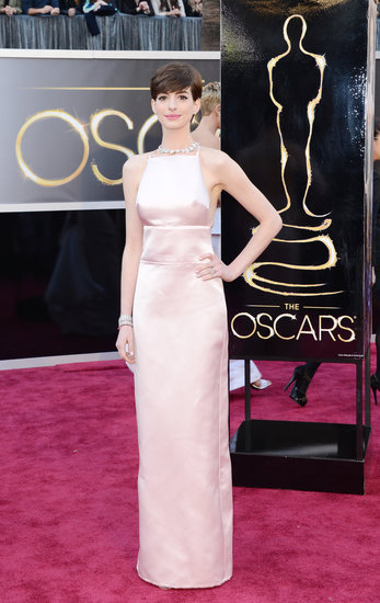 Oscar winner Anne Hathaway wore a pale pink Prada number highlighting a bow-detailed cutout back and Tiffany & Co. necklace.