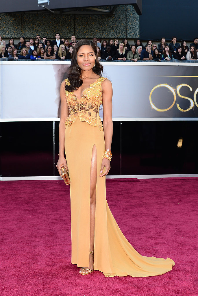 Skyfall actress Naomie Harris wore a gold dress by Michael Badger, winner of the Red Carpet Green Dress Challenge. The gown apparently took 120 hours to make and was hand embroidered with vintage beads and chocolate wrappers.