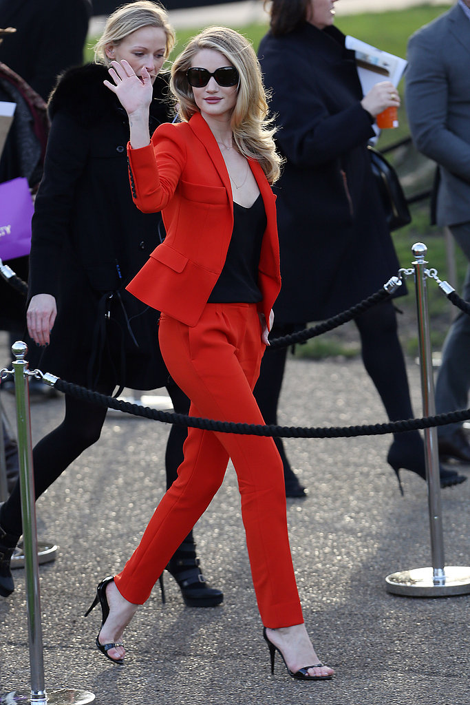 Rosie Huntington-Whiteley waved to her fans as she arrived at the Burberry Prorsum fashion presentation on Monday.