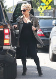 Jessica Simpson wore a military green jacket over her all-black outfit on Monday in LA.
