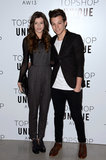 One Direction star Louis Tomlinson posed with girlfriend Eleanor Calder at the Topshop Unique Autumn/Winter 2013 fashion show on Sunday.