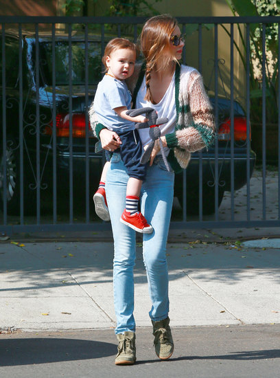 Miranda Kerr wore her hair in a braid while Flynn Bloom sported a pair of red shoes.