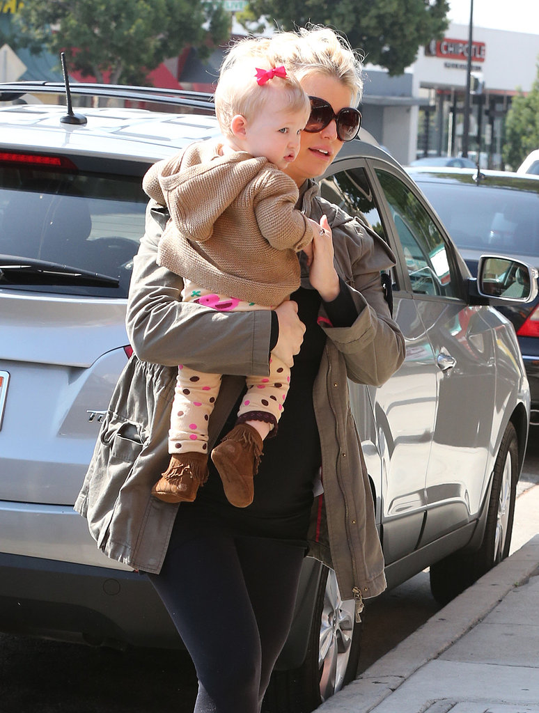 Jessica Simpson held baby girl Maxwell's hand as she carried her on the streets of LA on Monday.