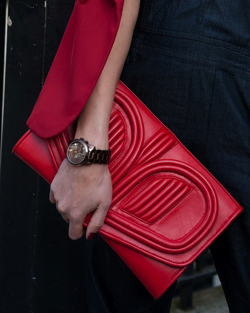 A red clutch popped against black separates.