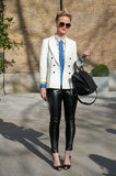 A preppy, boyish white blazer added charm to leather leggings.