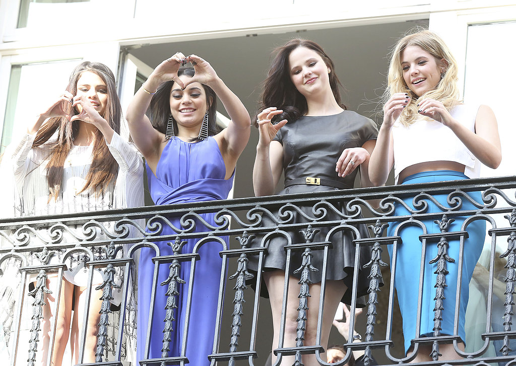 The cast of Spring Breakers, including Rachel Korine, waved to fans on the balcony of their hotel in Paris.