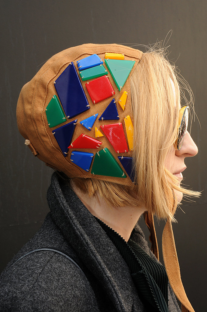 This LFW attendee sported an aviator hat adorned with multicolored stones.