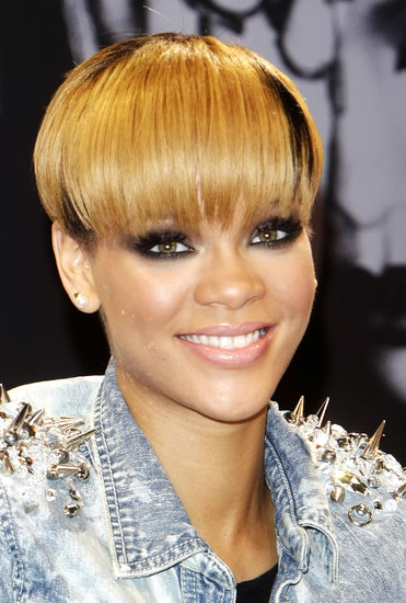 By 2010, Rihanna updated her look with a layer of golden blond highlights spattered about this much-talked-about bowl cut.