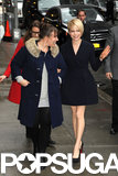 Michelle Williams showed off her legs in a short black coat in NYC.