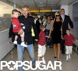 The young Beckham boys wore matching polos for a walk through London's Heathrow Airport in July 2007 with Mom and Dad.