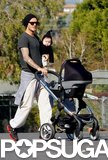 David Beckham had his hands full with baby girl Harper in LA in November 2011 before heading off to one of Romeo's soccer games.