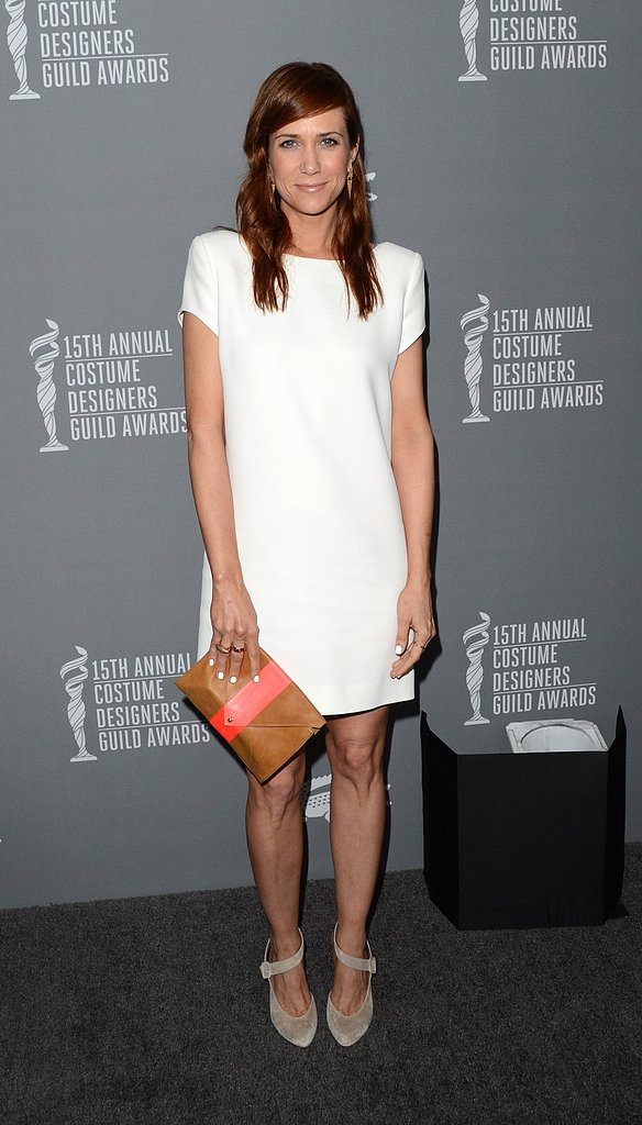 Kristen Wiig went minimalistic in a little white dress, gray ankle-strap Christian Louboutin pumps, and a two-tone clutch.
