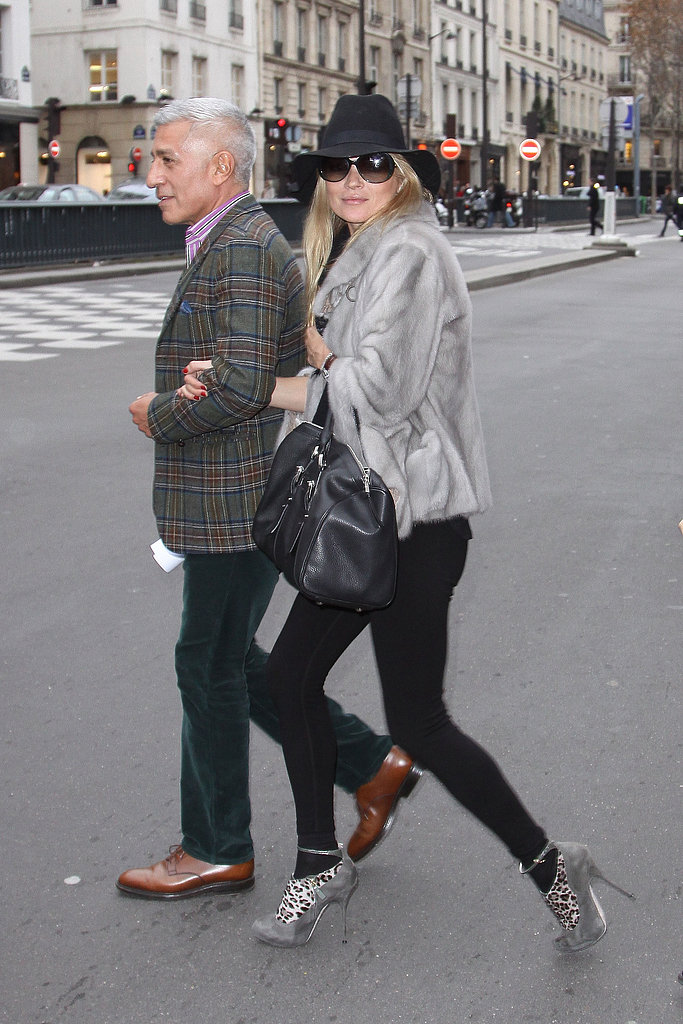 A floppy hat gave her slick black bottoms and fur a boho-rocker feel while visiting Paris.