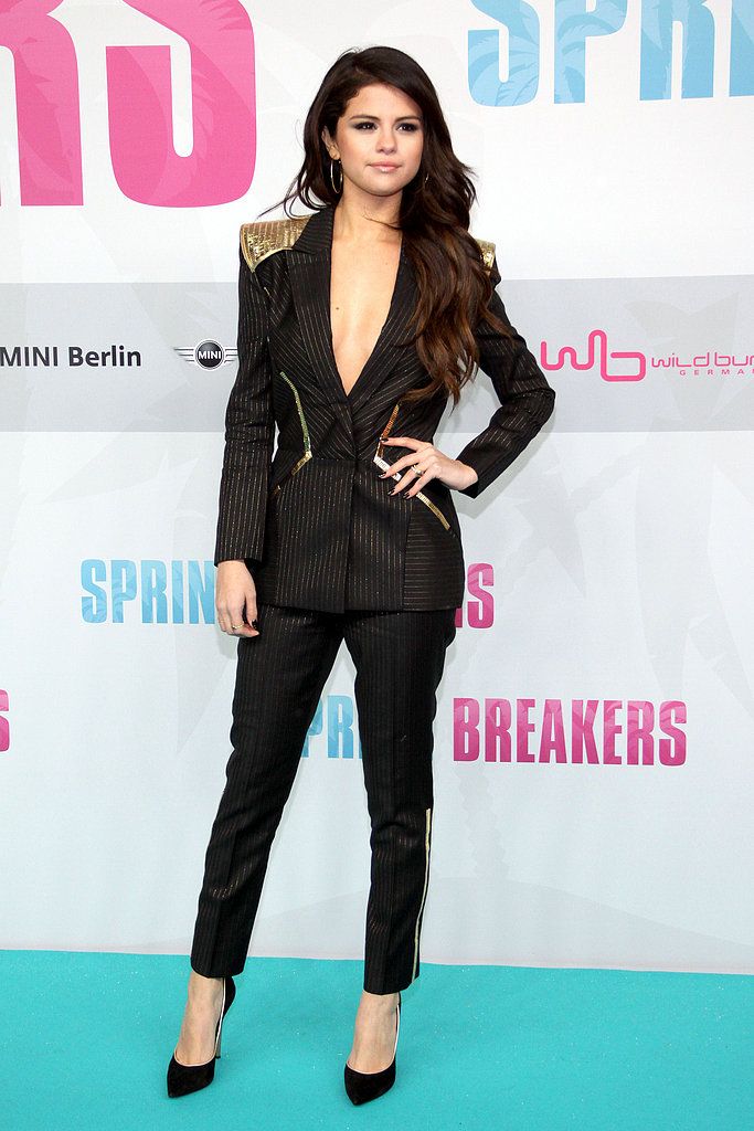 At the Berlin premiere of Spring Breakers, Selena Gomez took a sexy menswear approach in her black Atelier Versace pinstripe suit with gold detailing and Casadei pumps.