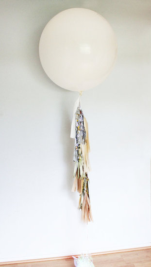 Anchor your bar or buffet with a festive visual, like this oversize tassel balloon ($27).