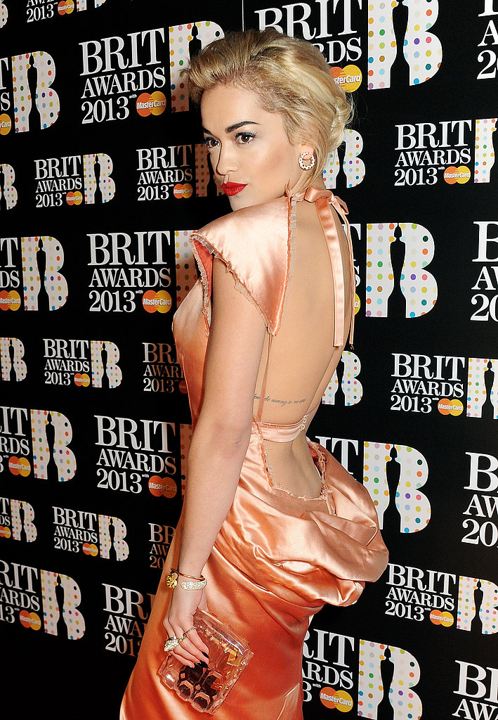 Rita Ora wore a backless peach gown to the Brit Awards.