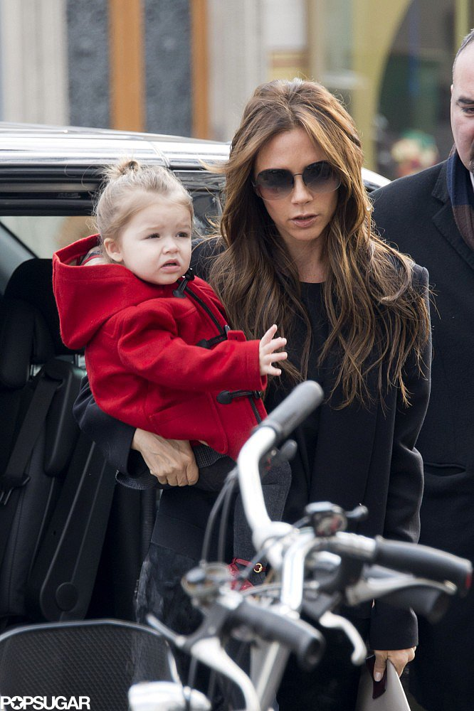 Victoria Beckham carried Harper Beckham in Paris.