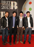 Mumford and Sons — Ted Dwane, Marcus Mumford, Ben Lovett, and Winston Marshall — hit the red carpet for the Brit Awards.