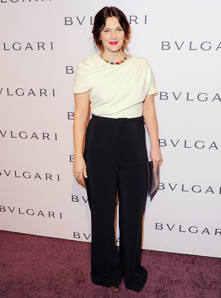 Drew Barrymore arrived wearing wide-legged pants.
