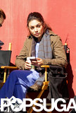 Mila Kunis took a break between takes on set Wednesday afternoon.
