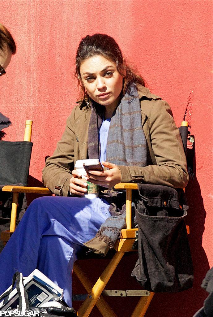 Mila Kunis took a break between takes on set Wednesday afternoon.