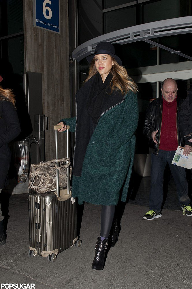 After touching down at the Charles de Gaulle Airport in Paris, Jessica bundled up in a green mohair Tory Burch coat, buckled Christian Louboutin ankle boots, and a fedora.