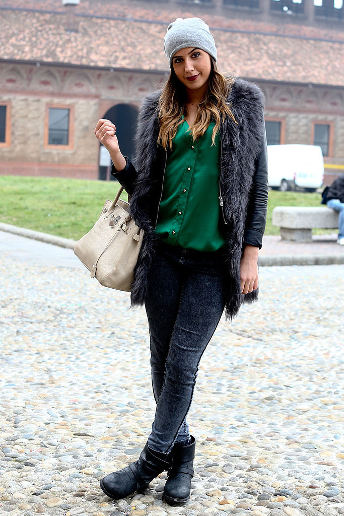 Street chic Milano style, with a luxe furry coat to counter her biker boots.
