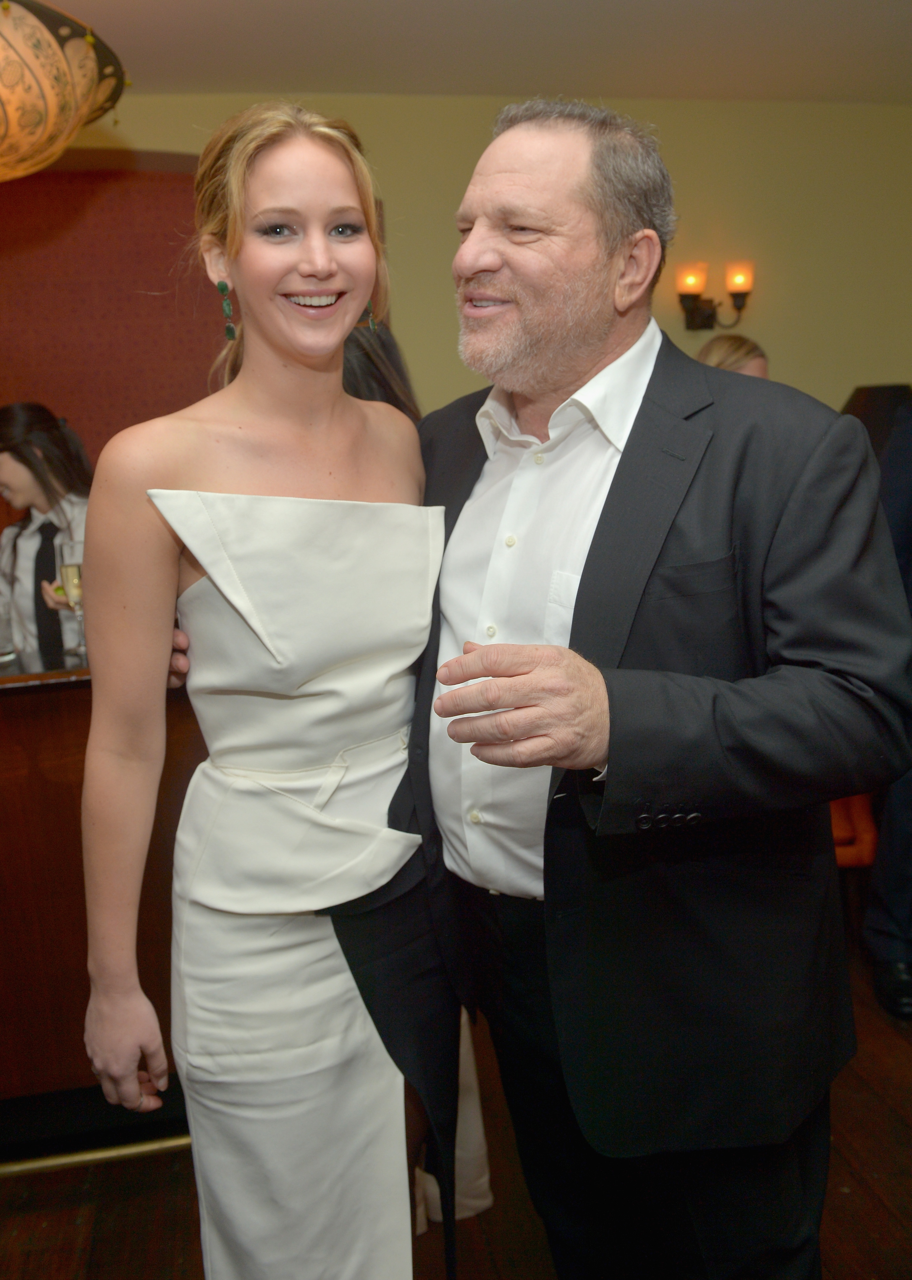 Jennifer Lawrence chatted with Harvey Weinstein at a pre-Oscars bash in LA on Wednesday night.