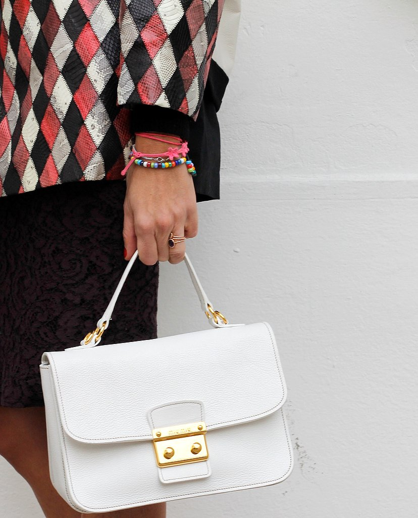 A sleek white satchel added a ladylike touch to dark separates.