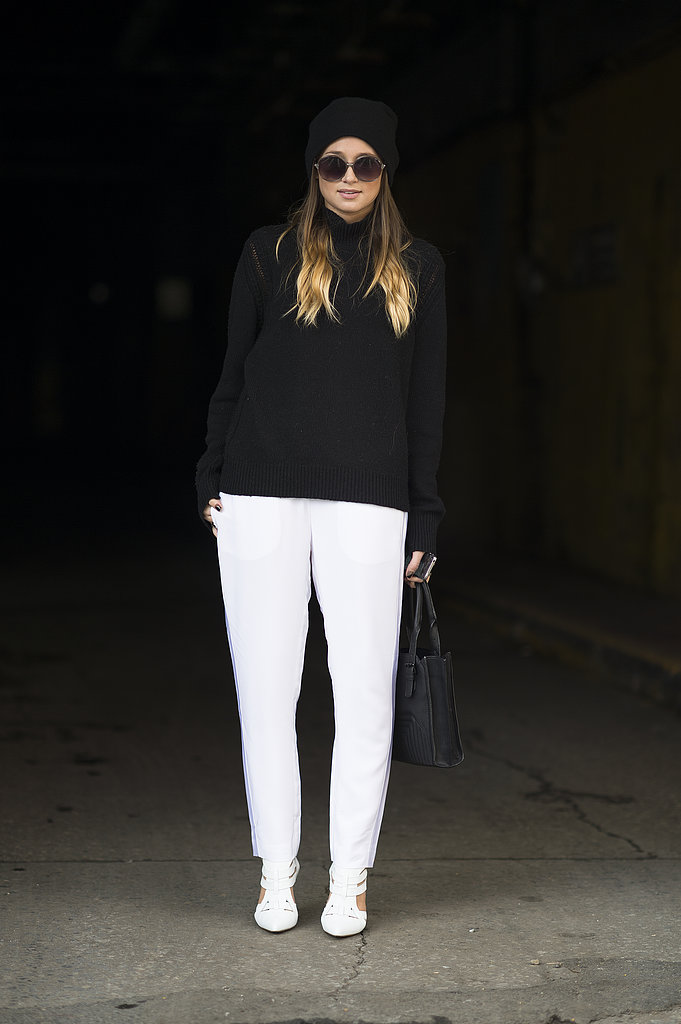 The easiest way to get the look may just be with a pair of white trousers and a black knit; then take it a step further with white heels and a black beanie. Source: Le 21ème | Adam Katz Sinding