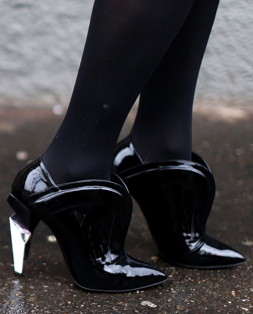 Black ankle boots were updated with a modern structural heel.