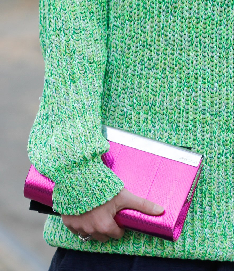 This style setter contrasted her cool hot-pink clutch against a bright green knit.