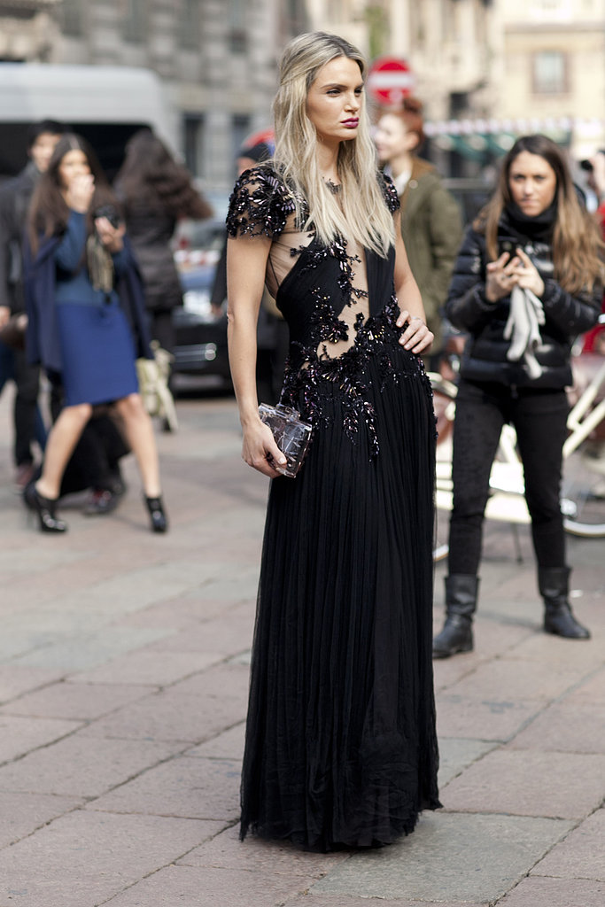 There are some that dress for function at Fashion Week; this glamorously attired showgoer is clearly not that type. She hit the shows in a red-carpet-ready gown.