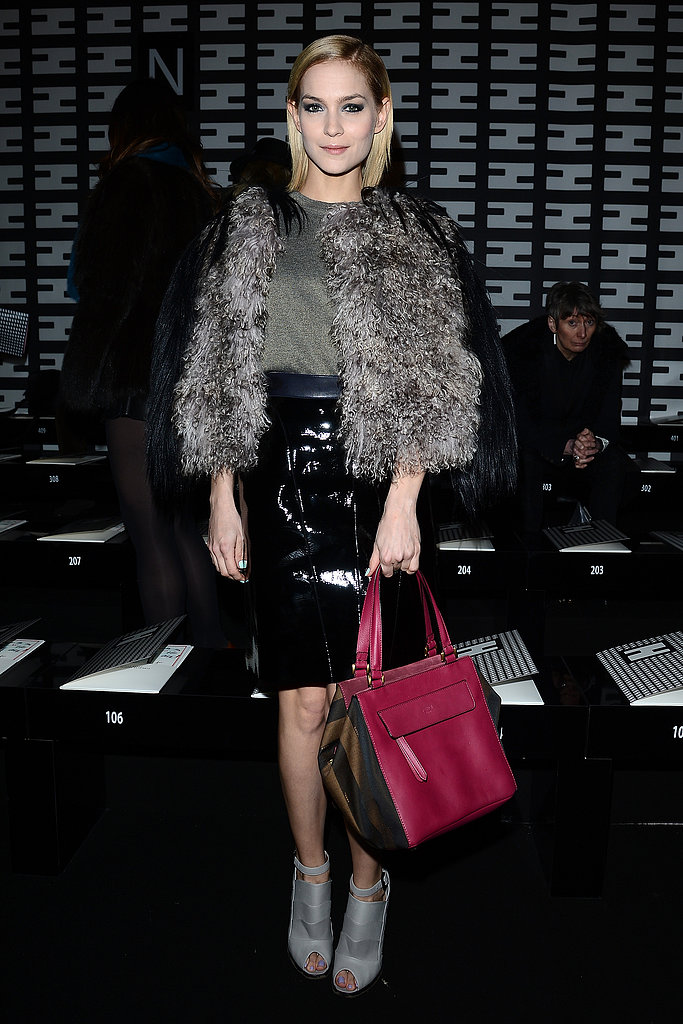 While sitting front row at Fendi, Leigh Lezark overdosed on texture in a mongolian fur coat, patent leather pencil skirt, and a metallic blouse.