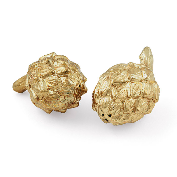 These brass artichoke salt and pepper shakers ($130) would bring a playful, polished touch to any tablescape.