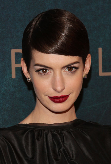 It was a dark and seductive style at the Les Misérables New York premiere. Anne wore her pixie tightly slicked down, with lots of lashes and a bold berry lip.