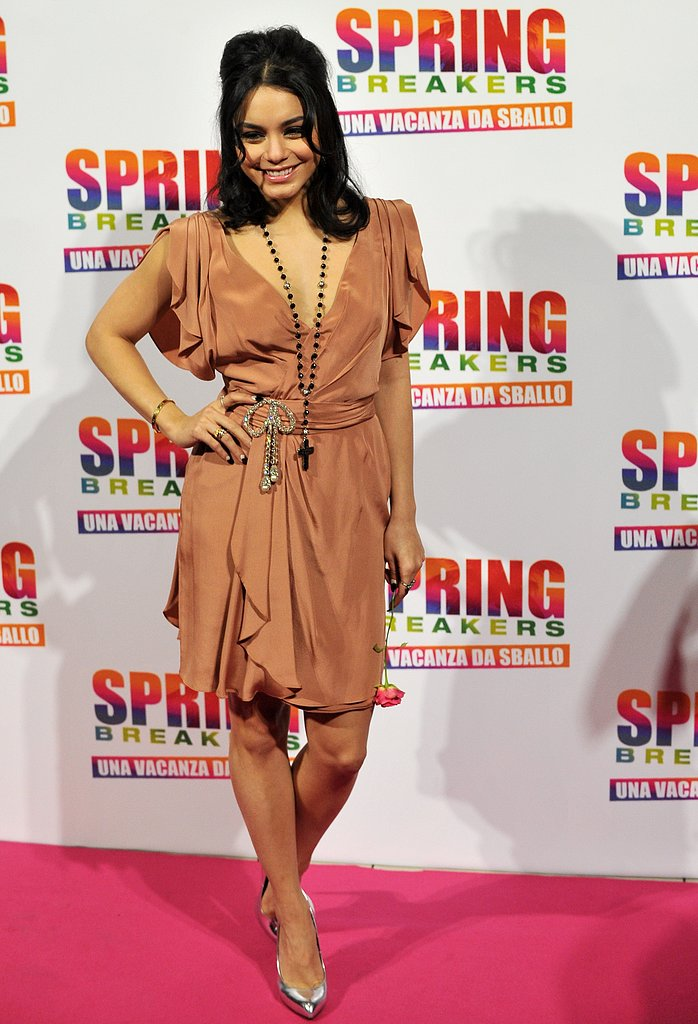 Vanessa Hudgens paired a peachy silk dress with silver metallic pumps and a black rosary necklace for the Rome photocall.