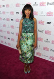 Kerry Washington was a vision in a sleeveless green floral-printed dress by Giambattista Valli Couture. The Scandal and Django Unchained actress is no stranger to bold prints and daring styling choices, which makes her textured clutch and matching floral Christian Louboutin pumps a gorgeous (if not expected) complement to her ensemble.