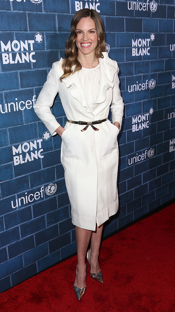 Hilary Swank was the epitome of feminine in an ivory ruffle coat and a metallic bow belt at the Montblanc and UNICEF brunch.