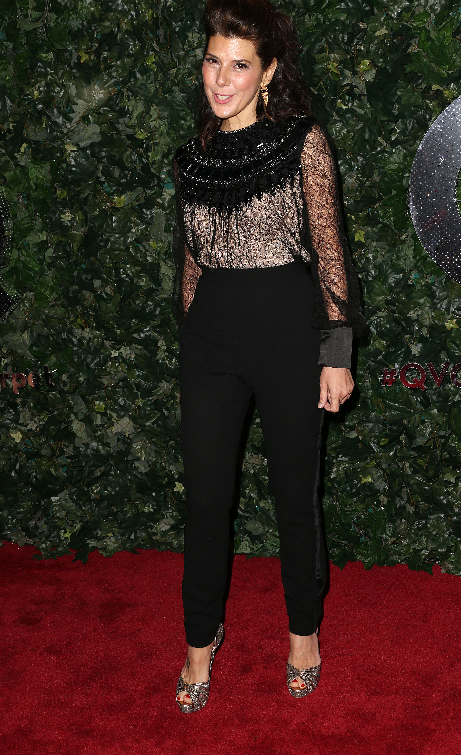 Marisa Tomei matched up a sheer lace blouse with black ...