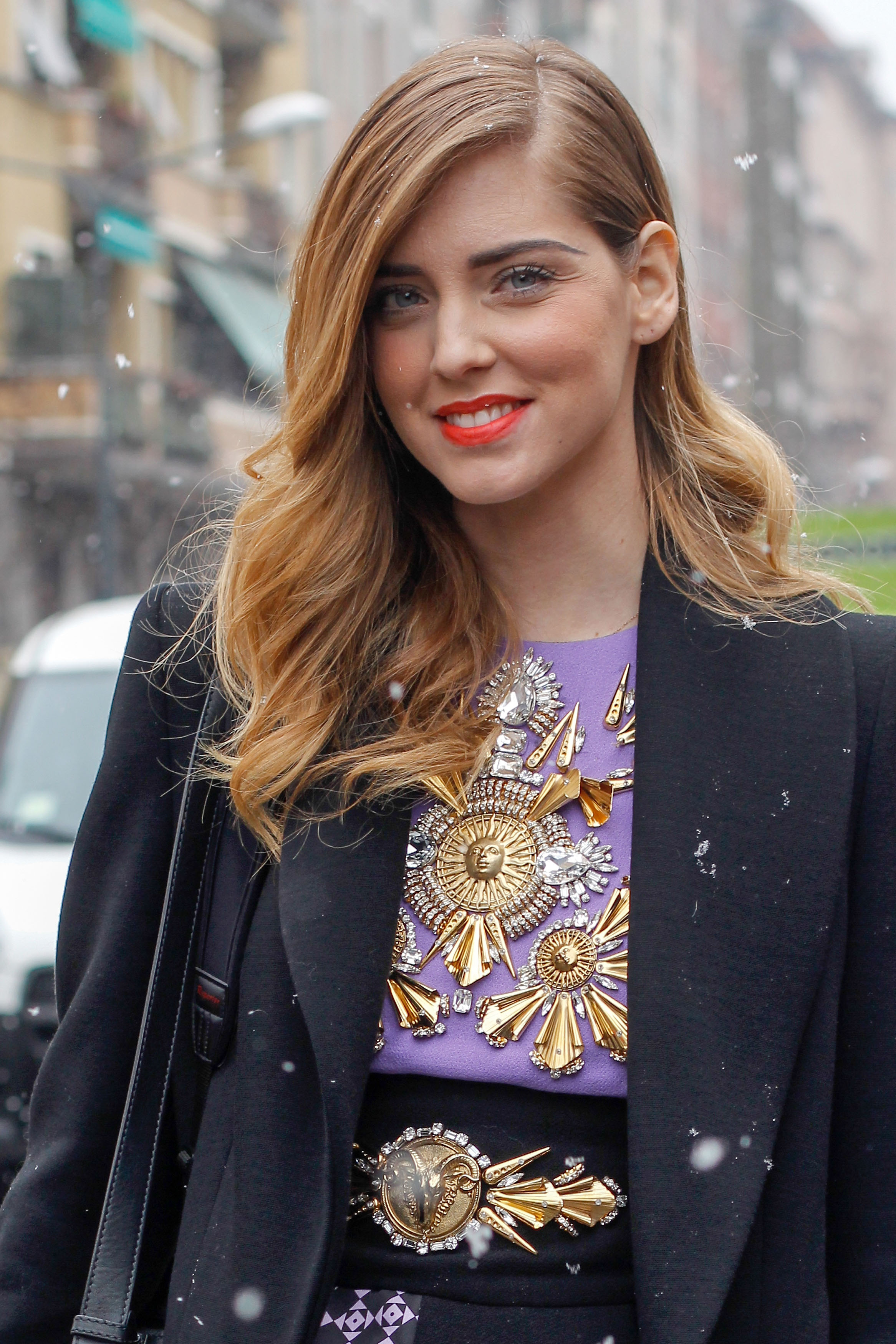 Chiara Ferragni of The Blonde Salad added a pop of color to her look with a swipe of tangerine lipstick.
