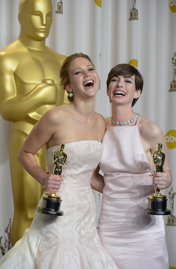 Jennifer Lawrence and Anne Hathaway laughed as they posed with their Oscars in the press room at the 2013 Academy Awards.
