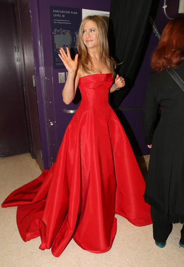 Jennifer Aniston gave a wave backstage at the Oscars.