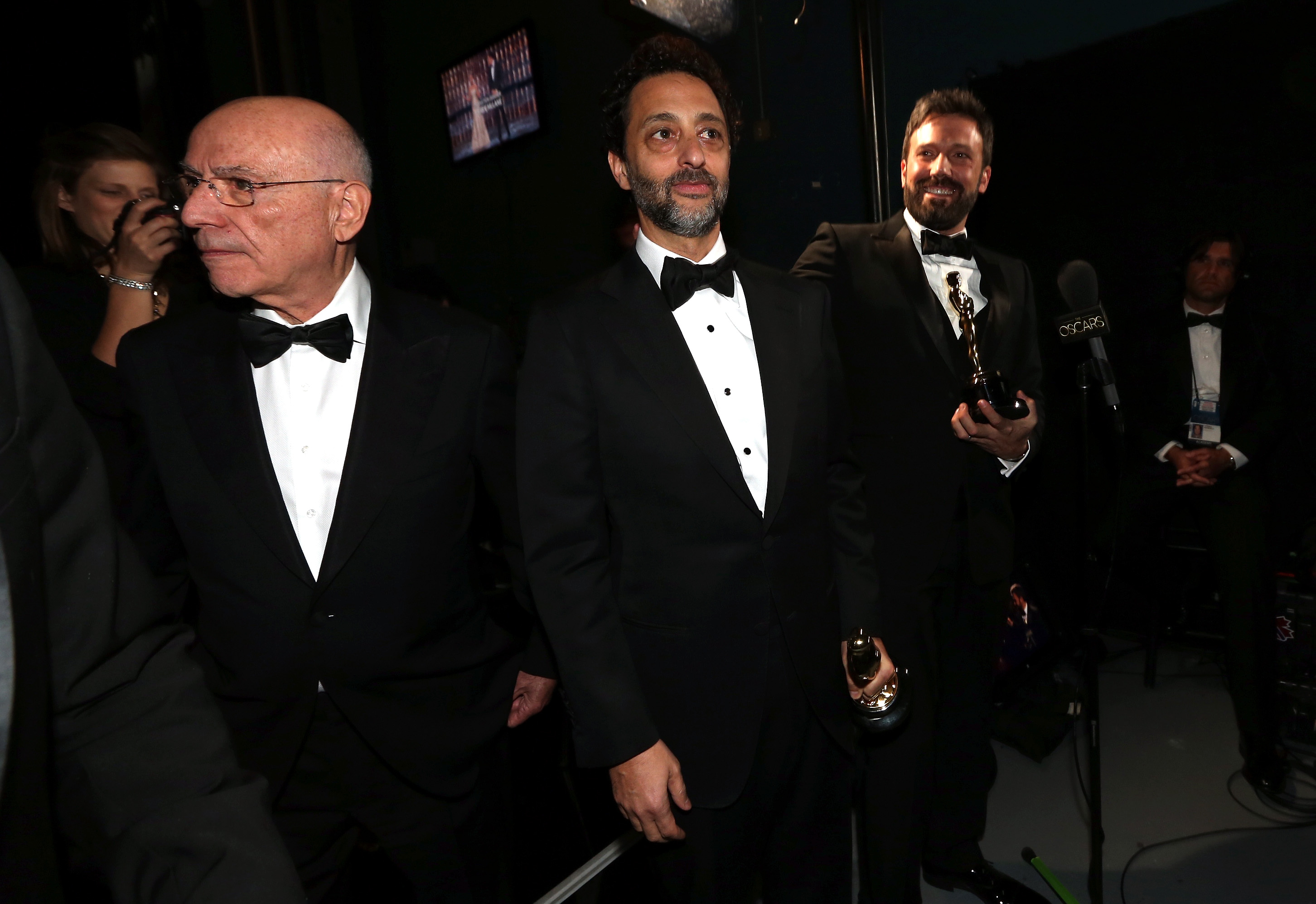 Grant Heslov, Alan Arkin, and Ben Affleck backstage at the 2013 Oscars.