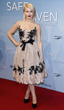 At the Berlin premiere of Safe Haven, Julianne Hough was ladylike with a dark twist in lace a fit-and-flare Zuhair Murad dress with black embellishments and a bow belt.