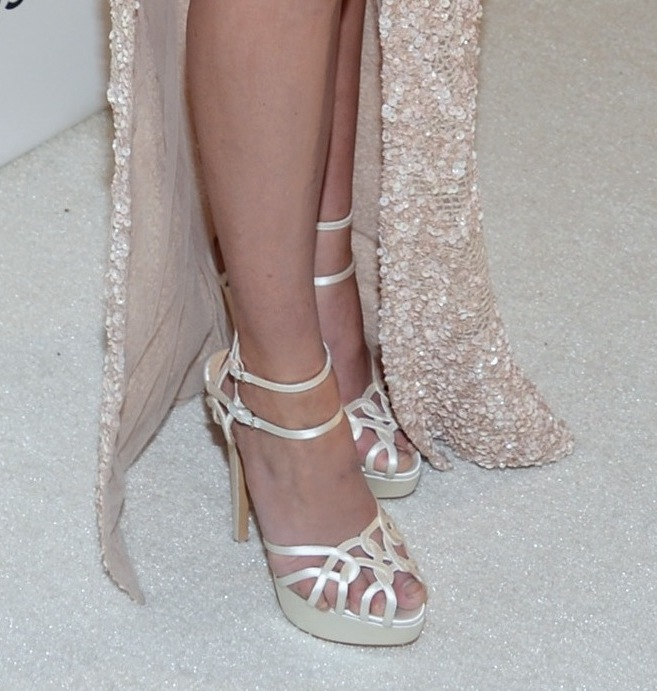 Analeigh Tipton picked ivory double-strap Charlotte Olympia sandals with her embellished Elie Saab gown at Elton John's soiree.